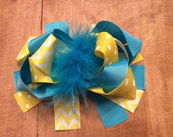 Turquoise and yellow multi layered bow