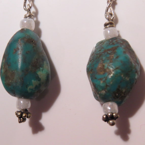Earrings African Turquoise and sterling silver earwires, white seed beads and lead free findings.