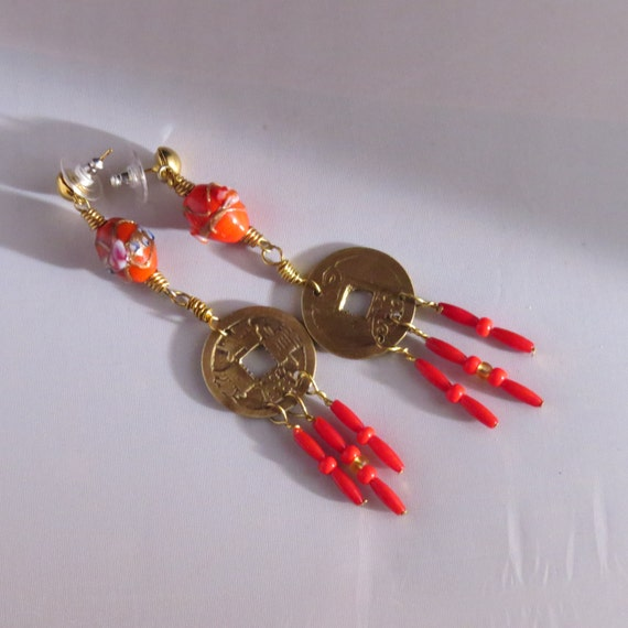 Earrings made of Ancient Chinese coins and beautiful Lampwork beads.