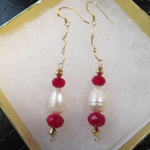 REDUCED TO 20.00/Reduced Shipping-Earrings made of freshwater pearls, red crystals and 14K gold ear wires.