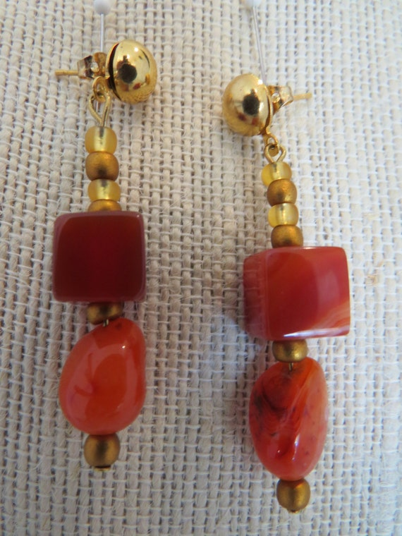 "Earrings made of Carnelian semi prescious gemstones, and gold tone wire 2 1/4"" dangle. ."