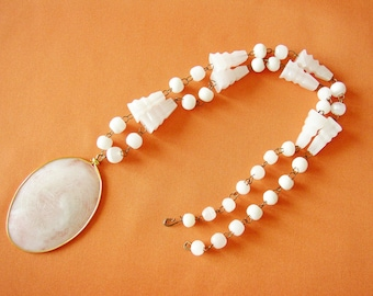 Bead necklace with oval engraved pendant Aztec motif white semi precious stone ethnic style