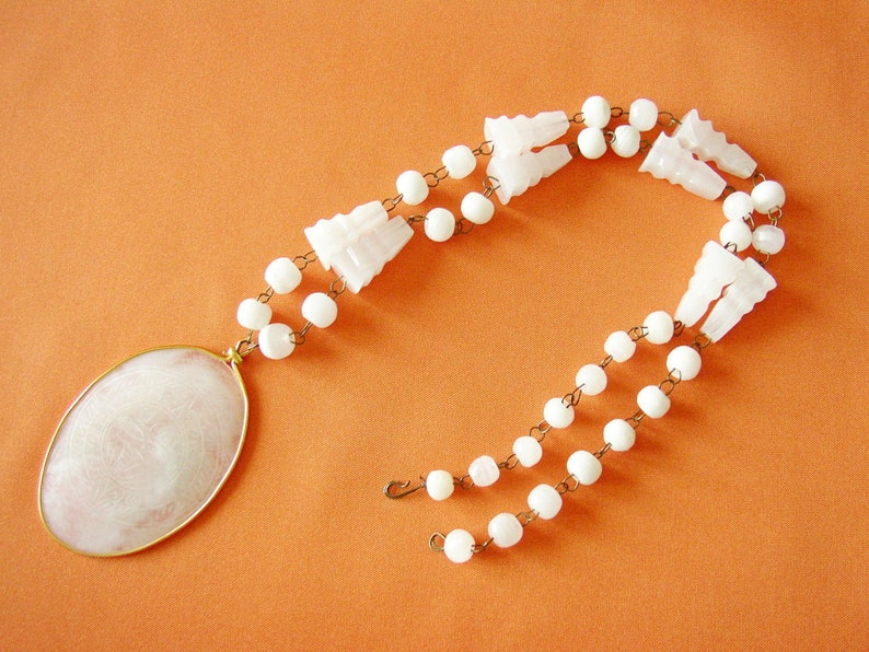 Bead necklace with oval engraved pendant Aztec motif white image 0