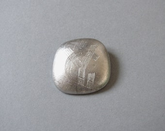 """YVES SAINT LAURENT - Silver plated brooch/pendant embellished with initials marked """"Made in France"""""""