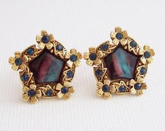 Pentagonal clip on earrings small flowers surrounding a faux rainbow cat's eye center