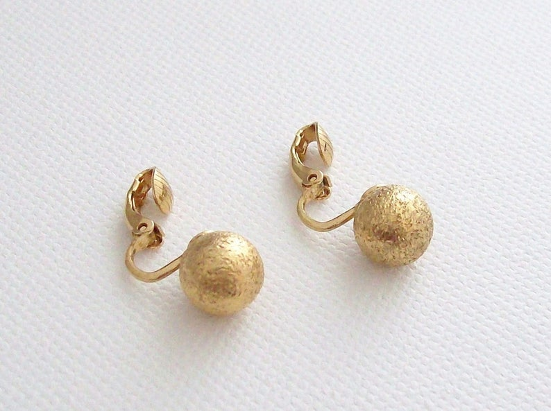 TRIFARI Crown  Small clip on earrings with textured balls image 0