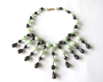 Art Deco fringe necklace with jade green and black carved plastic beads and black molded glass beads