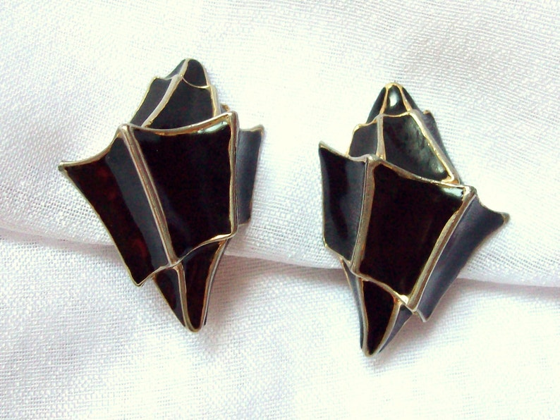 UNGARO  Black enamel on gilded metal clip on earrings special image 0