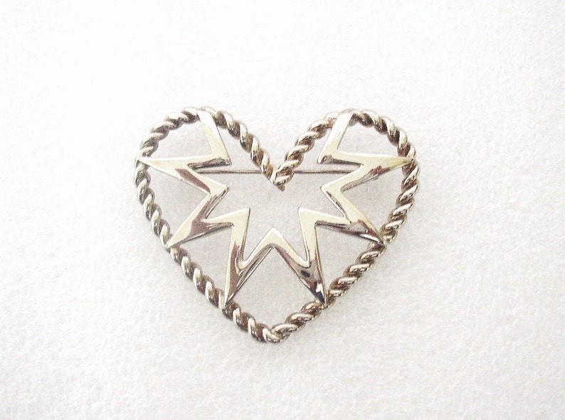 GIVENCHY  Openwork brooch heart shaped with star silver image 0