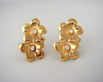 """YVES SAINT LAURENT - Stylized flower clip on earrings gilded metal with crystal hearts signed """"Made in France"""""""