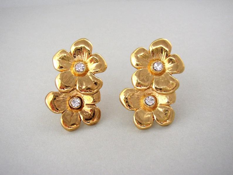 YVES SAINT LAURENT  Stylized flower clip on earrings gilded image 0
