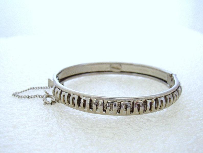 FREIRICH  Silver tone bracelet embellished with antiqued image 0