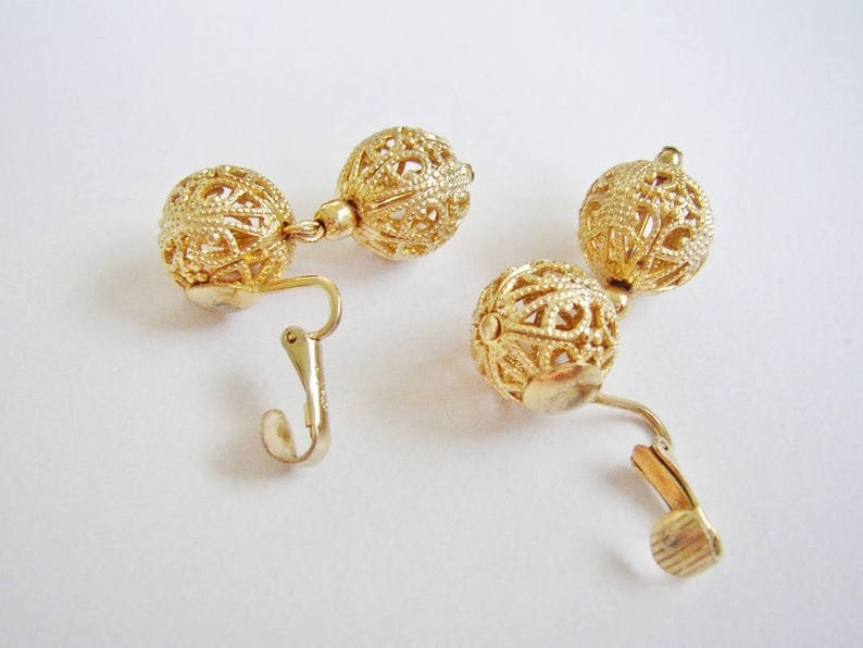JUDY LEE  Clip on gold tone dangle earrings filigree round image 0