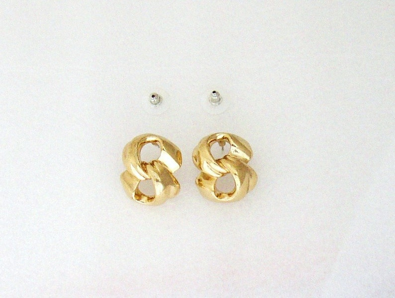 GIVENCHY  Love knot gilded metal pierced earrings 1980s image 0