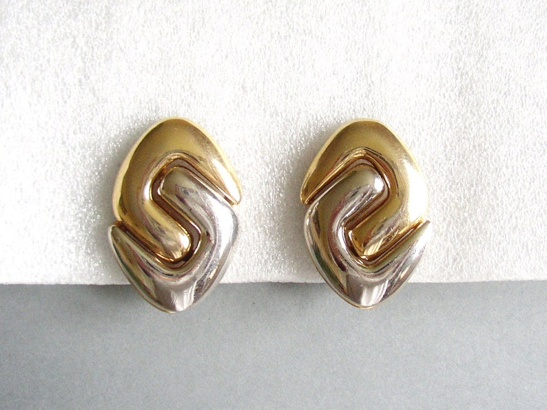 ANDRÉ COURRÈGES  Bold silver and gold tone clip on earrings image 0