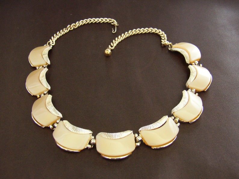 ART signed  Gold tone choker adorned with beige  thermo set image 0