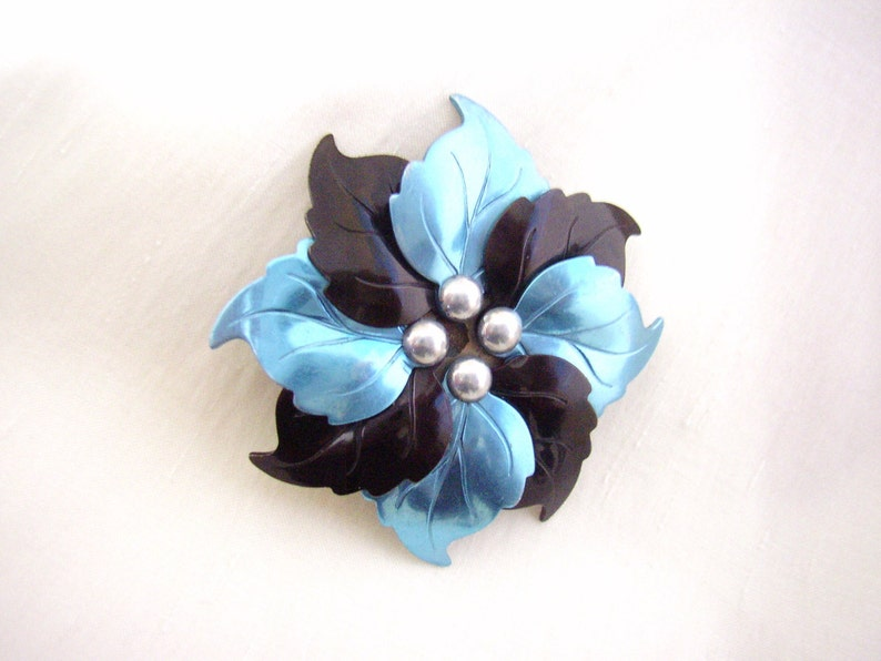 Art Deco brooch pendant stamped metallic blue and black leaves image 0