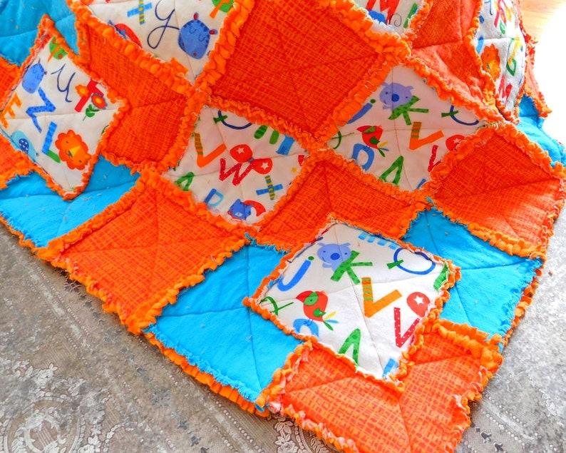 Poussette orange et bleu Minky Rag Quilt