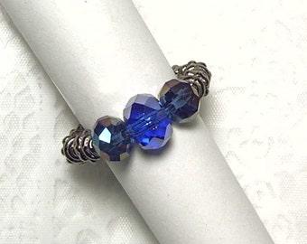 "Cynthia Lynn ""MYSTERIOUS"" Gunmetal and Jet Blue Crystal Glass Bead Stretch Ring sz 5-6 or 7-8"