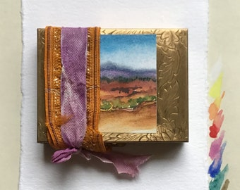 A Watercolor Set In a  Brass Compact