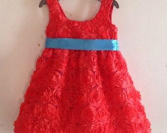 Orange rosette dress with satin belt and bow