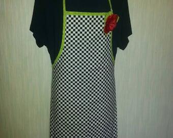 Black and white checkered apron.