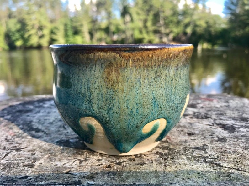 Small handmade turqoise and rust bowl