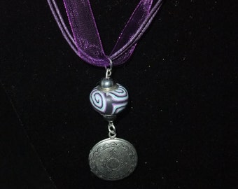 Silver Locket on Purple Ribbon