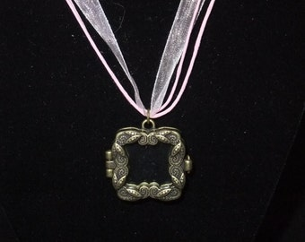Gold Frame Locket on Pink Ribbon