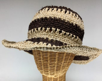 100% hemp straw sun hat brown stripe, 3 inch wire shapable brim.  Ultraviolet light resistant, mold resistant so can be out in rain or shine
