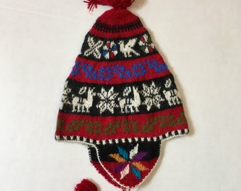 100% Baby Alpaca hand knit earflap hat, snowboarder hat, soft, red, black, images of the llamas and flower of life. For men, women
