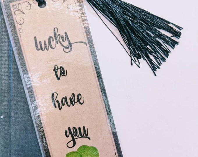 Genuine four leaf clover bookmark.