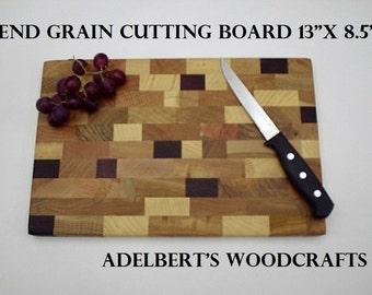 "13"" x 8.5"" x 1 "" wood cutting board  Made in America."