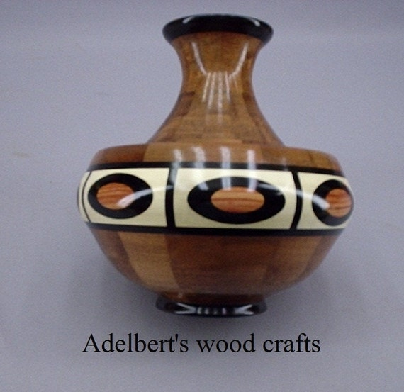 Exotic turned wood segmented vessel. Free shipping in USA.