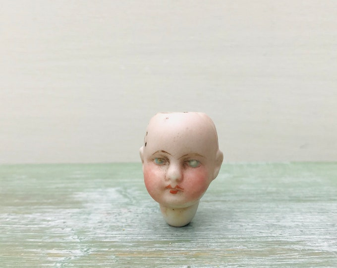 Antique Porcelain Bisque German Doll Head With Painted Blue Eyes.