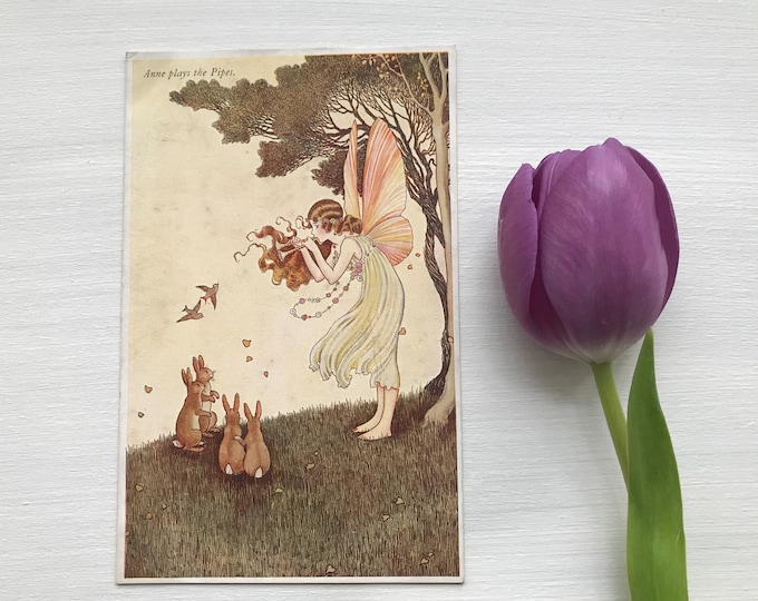 1930s Postcard of Fairy with Rabbits, Ida Rentoul Outhwaite Series 76 The Enchanted Forest, Anne Plays the Pipes, A & C Black