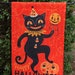 Terrie Burdette reviewed Small Garden Flag Halloween Dancing Black Cat Johanna Parker Design Garden Flag