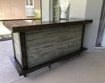 The All Wood Thomas Shabby  - 3' x 8' X 3' two level  Rustic barn wood look or pallet style indoor / outdoor bar with casters and foot rail