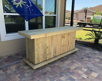 The Straight Eight - 8' rustic treated wood outdoor patio bar with casters, footrail and 2 shelves