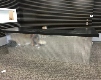 The Diamond U -4.5' x  9' x 4.5' u shaped diamond tread plate sales counter, reception desk, dry bar