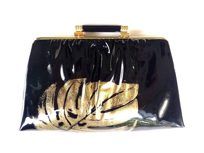 vintage patent leather clutch with gold monstera / tropical image 0