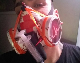 Blood Splatter Respirator with Syringe & Orange LED Tubing.
