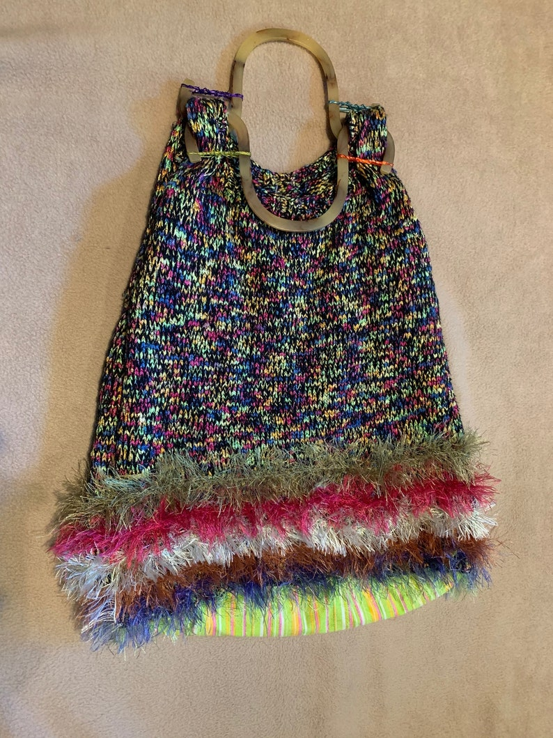 Triangle multi bag with tortoise-colored shell handles