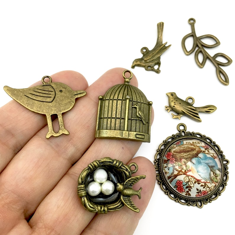 7 bird and nest charms bronze tone collection,13mm to 37mm # ENS B 112