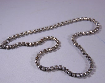 One Strand Crystal Clear Rhinestone Silver Tone Necklace. 15 1/4'' Long
