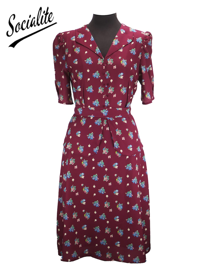 1940s Dress Styles Revival Socialite Replica 1940s Vintage Floral Symphony Peplum Dress $103.47 AT vintagedancer.com