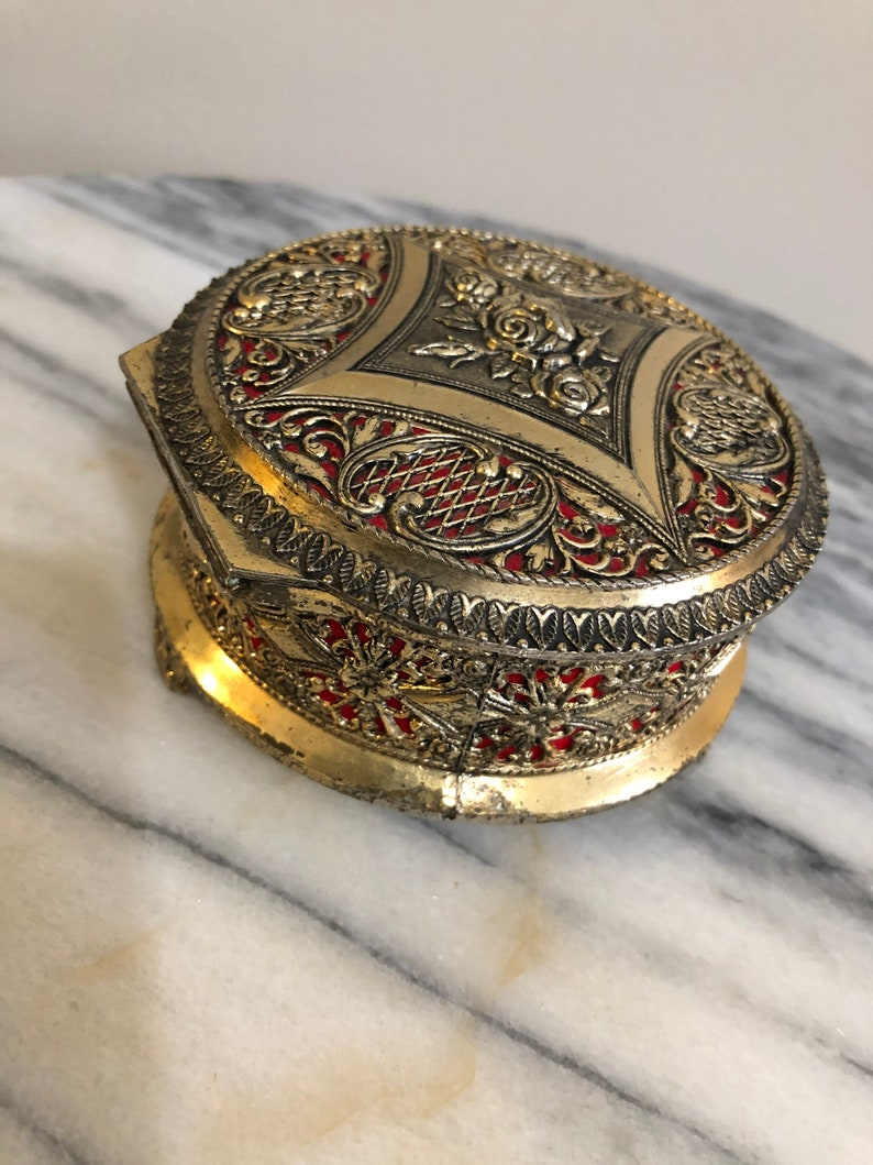 853b681b5 Pretty little vintage round metal jewelry box with red cloth   Etsy