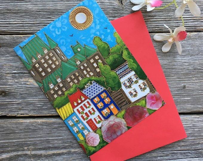 Greeting card colourful houses roses castle