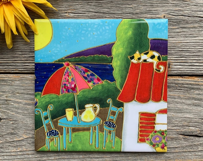 "Ceramic tile, houses, table with parasol, lake, cat, flower, 6"" x 6"", decoration, square trivet, Art print by Isabelle Malo"