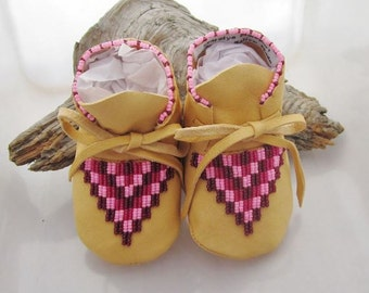 Pink Beaded Baby Moccasins and Soft Soled Girls Shoes made of soft leather, ideal for infants and toddlers learning to walk